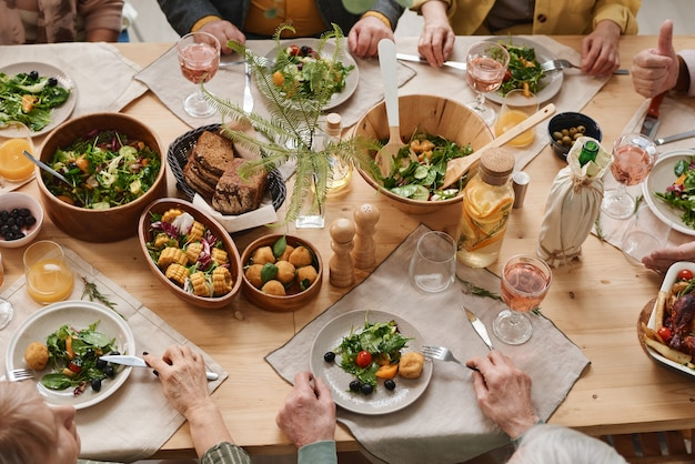 High angle view of dining table with different dishes serving for holiday dinner