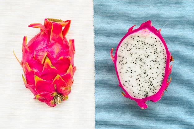 High angle view of dragon fruits on colorful table cloth