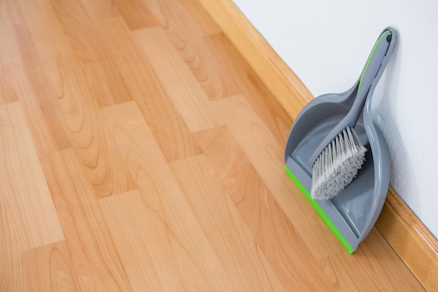 High angle view of dustpan and brush against wall