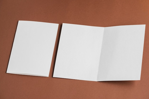 High angle view of folded and unfolded blank white papers