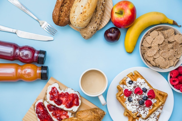 High angle view of fresh breakfast on blue background