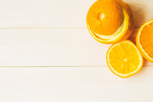 High angle view of fresh orange fruit on wooden background
