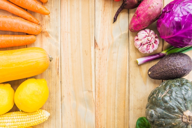 High angle view of fresh organic vegetables on wooden background