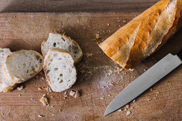 High angle view of freshly baked bread slices on wooden chopping board