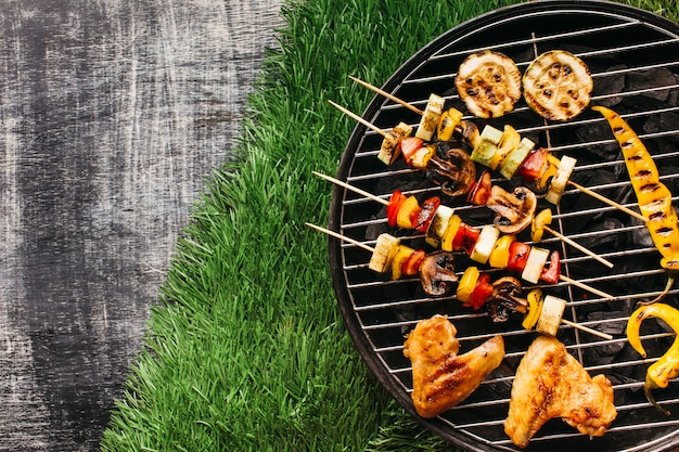 High angle view of grilled meat and vegetable on grill
