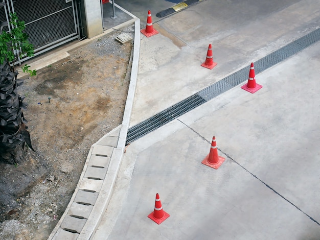 High angle view of group of orange plastic road cones