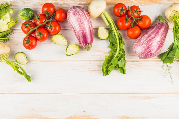 High angle view of healthy organic vegetables on wooden plank