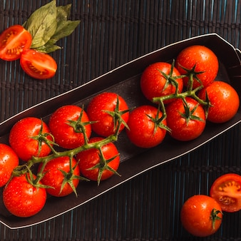 High angle view of juicy red tomatoes in tray