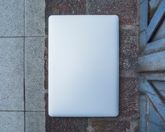 High angle view of a laptop on stone pavement