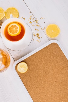 High angle view of lemon tea on wooden surface