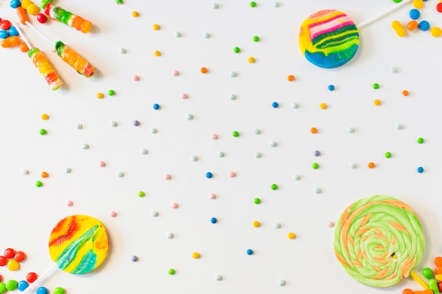 High angle view of lollipops and candies on white background