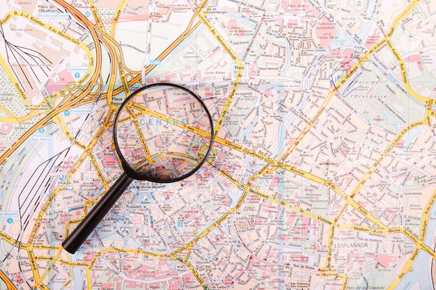 High angle view of magnifying glass on map