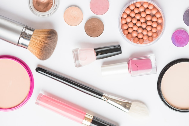 High angle view of makeup kits on white background