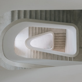 High angle view of a modern spiral staircase in an exhibition under the lights