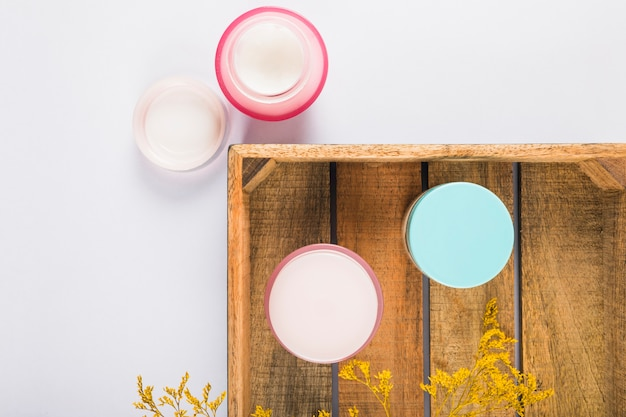 High angle view of moisturizing creams