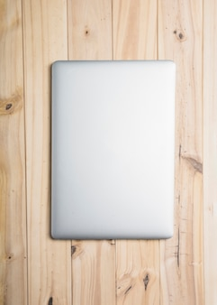 High angle view of a laptop on wooden backdrop