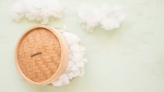 High angle view of a wicker steamer with white cotton