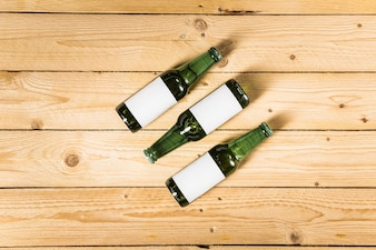 High angle view of alcoholic bottles on wooden surface