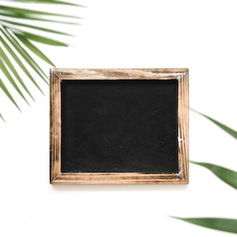 High angle view of black slate over white background