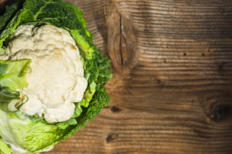 High angle view of cauliflower on wooden background