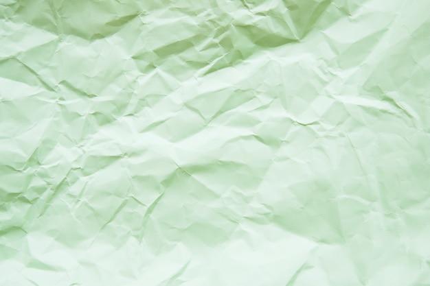 Высокий угол зрения зеленой бумаги текстурированный фон