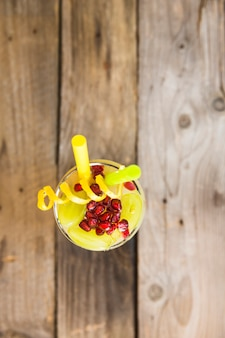 High angle view of healthy fruit juice on wooden background