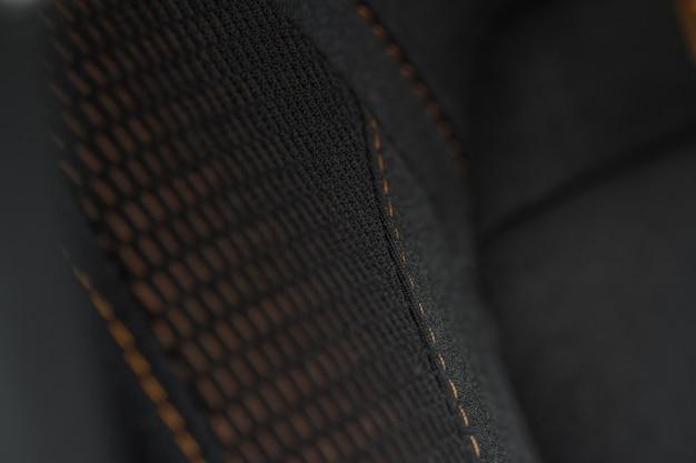 Высокий угол обзора современных автомобильных тканевых сидений. текстура автомобильного сиденья крупным планом и детали интерьера. детальное изображение машинной вышивки складки.