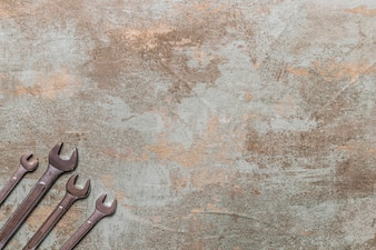 High angle view of spanners on old wooden background