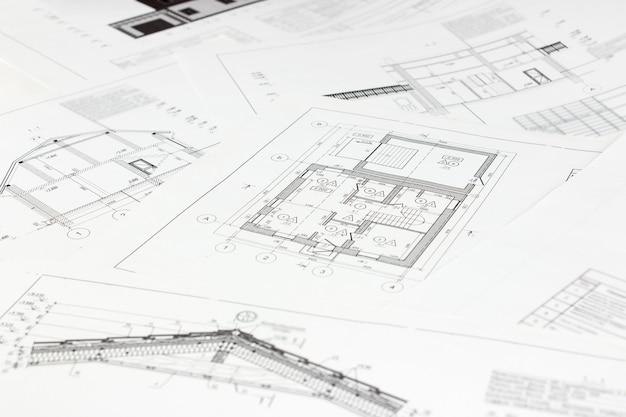 建築計画のハイアングルビュー。建築デザインプロジェクトのコンセプト。紙の建築