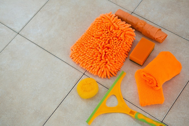 High angle view of orange cleaning products