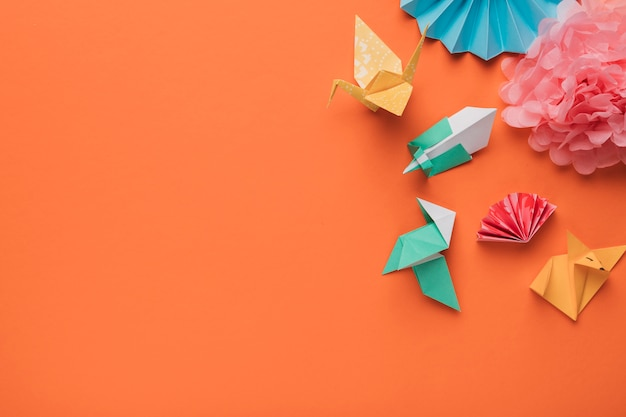 High angle view of origami paper art craft on orange surface
