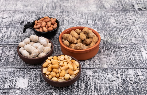High angle view peanuts in bowls on wooden