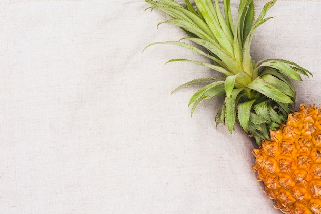 High angle view of pineapple on white textile