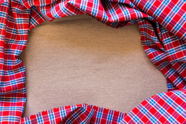 High angle view of plaid pattern textile forming frame
