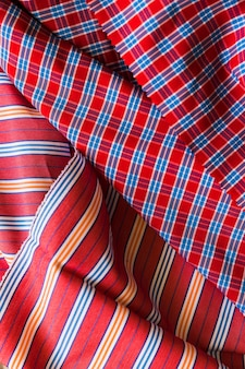 High angle view of plaid and stripes pattern fabric material