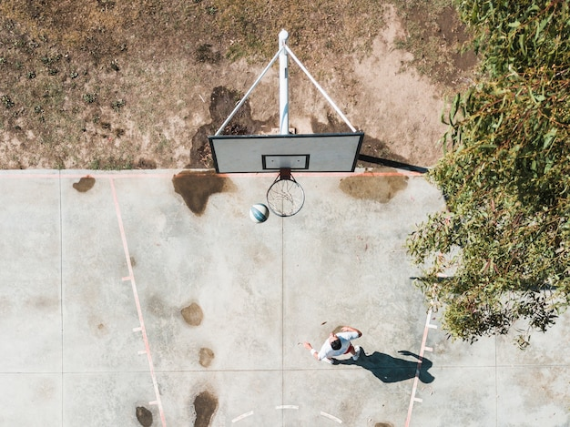 High angle view of player throwing basketball in the hoop