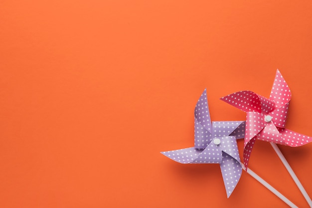 High angle view of polka dotted pinwheel on orange backdrop