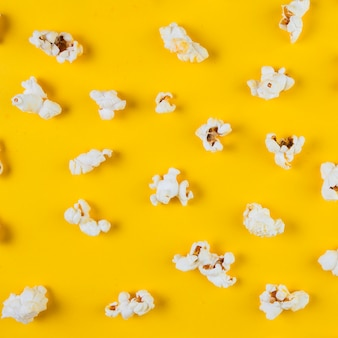 High angle view of popcorn on yellow background