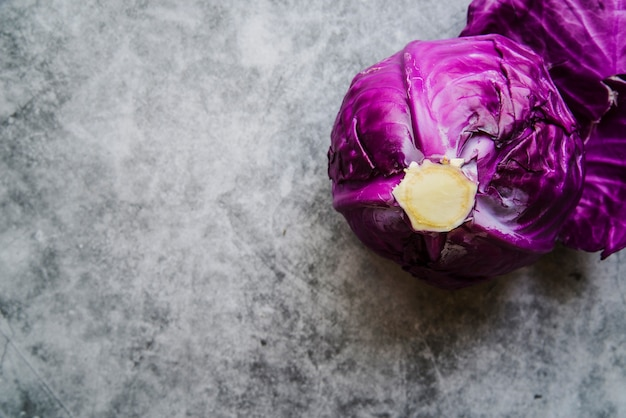 High angle view of purple cabbage on concrete background