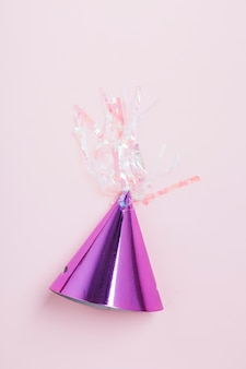 High angle view purple party hat on pink background