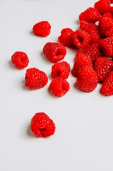 High angle view raspberries on white background. vertical