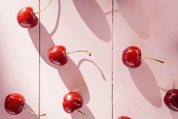 High angle view of red cherries on wooden plank