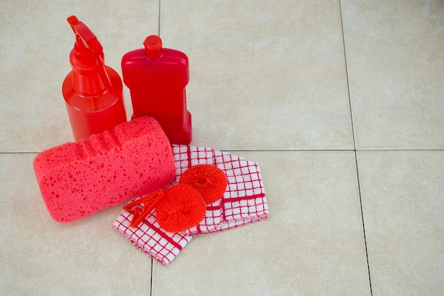 High angle view of red cleaning products with napkin