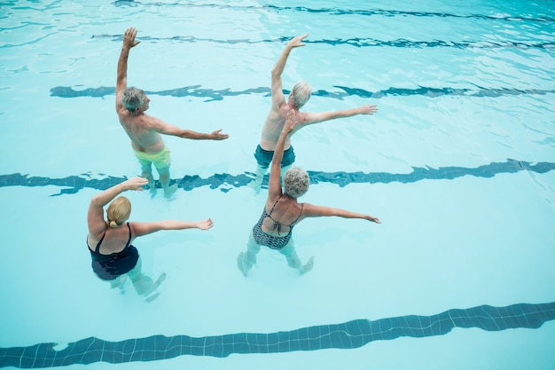 High angle view of senior swimmers exercising in swimming pool
