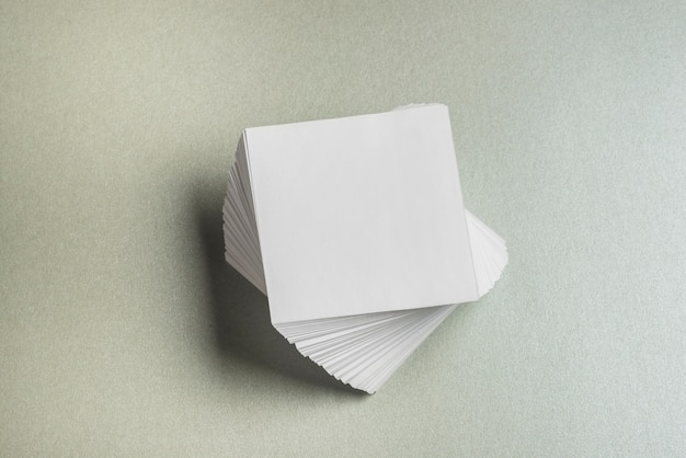 High angle view of stacked square shaped paper