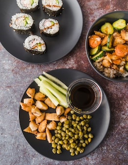 High angle view sushi with vegetables plates