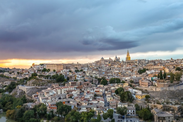 High angle view of the toledo city in spain under the dark cloudy sky