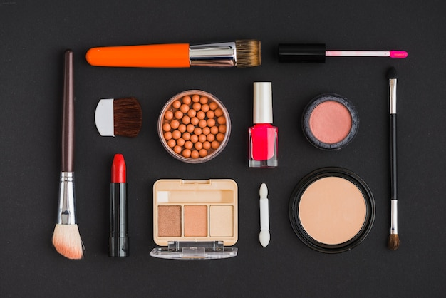 High angle view of various cosmetic products arranged in rectangular shape