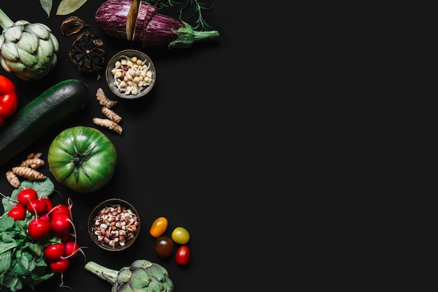 High angle view of various vegetables on black background
