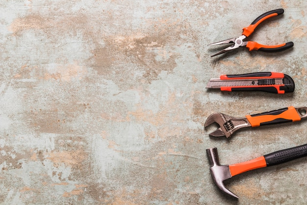 High angle view of various worktools on old wooden background